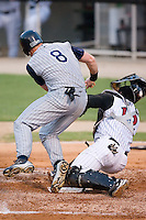 Lake County designated hitter Nick Weglarz (8) collides with Kannapolis catcher Francisco Hernandez (12) at Fieldcrest Cannon Stadium in Kannapolis, NC, Saturday, August 11, 2007.  Weglarz was safe on the play as Hernandez could not hold on to the ball.