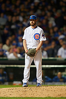 Chicago Cubs pitcher Travis Wood (37) gets ready to deliver a pitch in the seventh inning during Game 4 of the Major League Baseball World Series against the Cleveland Indians on October 29, 2016 at Wrigley Field in Chicago, Illinois.  (Mike Janes/Four Seam Images)