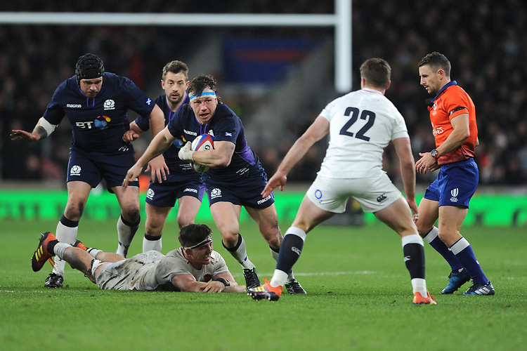 Hamish Watson of Scotland beats Mark Wilson of England and eyes up George Ford of England  during the Guinness Six Nations Calcutta Cup match between England and Scotland at Twickenham Stadium on Saturday 16th March 2019 (Photo by Rob Munro/Stewart Communications)