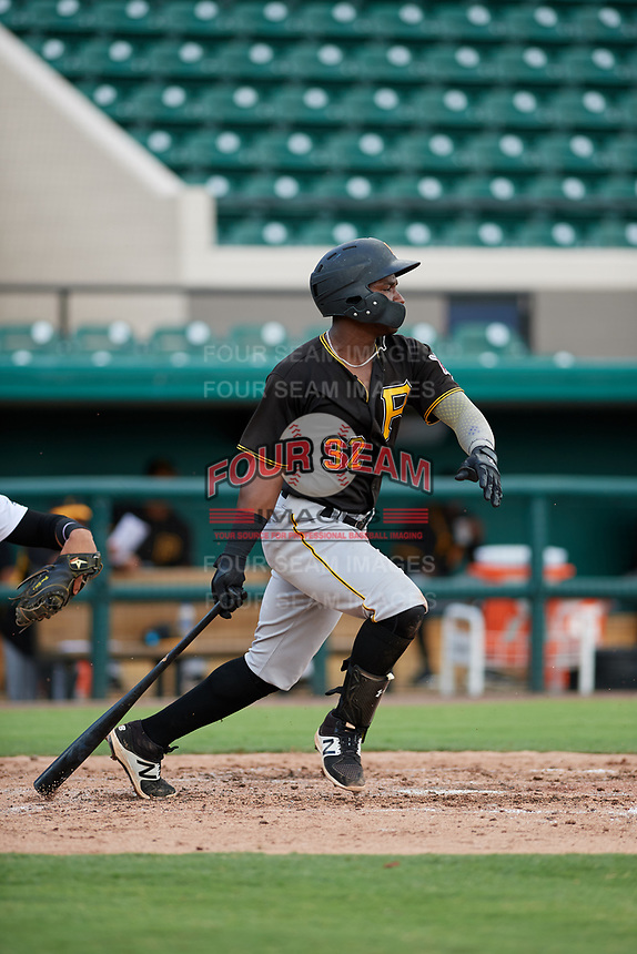 Pittsburgh Pirates Rodolfo Castro (32) follows through on a swing during a Florida Instructional League game against the Detroit Tigers on October 6, 2018 at Joker Marchant Stadium in Lakeland, Florida.  (Mike Janes/Four Seam Images)