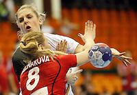 Germanyís Susann Muller (top) vies with Czech Republic's Pavla Poznarova and Petra Vitkova (R) during their Women's Handball World Championship 2013 match Czech Republic vs Germany on December 9, 2013 in Novi Sad.   AFP PHOTO / PEDJA MILOSAVLJEVIC