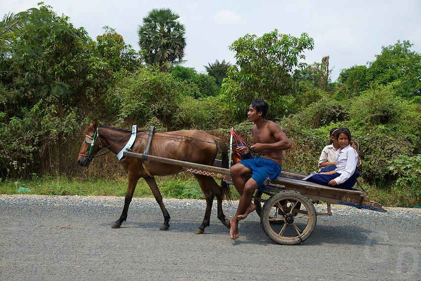 School children using the local transportation on Silk Island, Cambodia