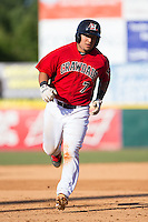 Jose Trevino (7) of the Hickory Crawdads rounds the bases after hitting a home run against the Savannah Sand Gnats at L.P. Frans Stadium on June 14, 2015 in Hickory, North Carolina.  The Crawdads defeated the Sand Gnats 8-1.  (Brian Westerholt/Four Seam Images)