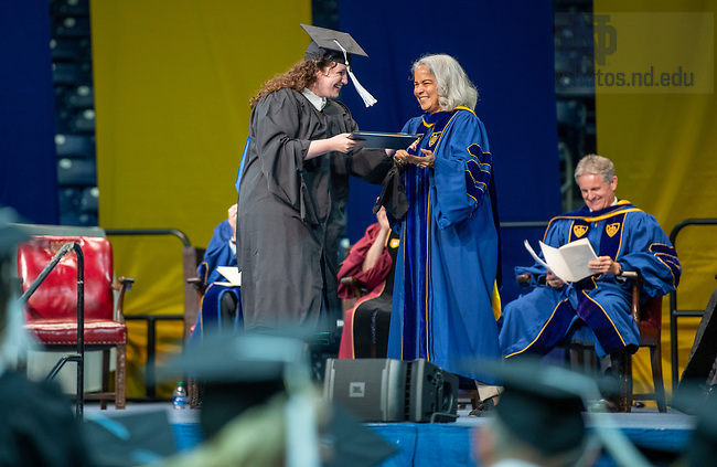 July 10, 2021; 2021 Provost Marie Lynn Miranda hands a graduate her diploma during the Commencement Ceremony of the University of Notre Dame's Alliance for Catholic Education (ACE) in the Purcell Pavilion of the Joyce Center. (Photo by Barbara Johnston/University of Notre Dame)