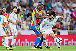 Isco Alarcon (r) of Real Madrid battles for the ball with Geoffrey Kondogbia of Valencia CF during their La Liga 2017-18 match between Real Madrid and Valencia CF at the Estadio Santiago Bernabeu on 27 August 2017 in Madrid, Spain. Photo by Diego Gonzalez / Power Sport Images