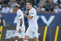 CARSON, CA - JUNE 19: Sacha Kljestan #16 of the Los Angeles Galaxy celebrates his PK goal with Julian Araujo #2 during a game between Seattle Sounders FC and Los Angeles Galaxy at Dignity Health Sports Park on June 19, 2021 in Carson, California.