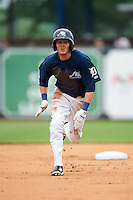West Michigan Whitecaps outfielder Austin Schotts (5) running the bases during a game against the Cedar Rapids Kernels on June 7, 2015 at Fifth Third Ballpark in Comstock Park, Michigan.  West Michigan defeated Cedar Rapids 6-2.  (Mike Janes/Four Seam Images)