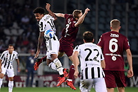Weston McKennie of Juventus FC and Tommaso Pobega of Torino Calcio compete for the ball during the Serie A 2021/2022 football match between Torino FC and Juventus FC at Stadio Olimpico Grande Torino in Turin (Italy), October 2nd, 2021. Photo Federico Tardito / Insidefoto