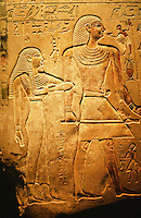Egypt:  Limestone relief of Stele of Anhurnakhte, about 2150 B.C. First intermediate period.  Size indicates importance; tomb owner larger than wife, and much larger than son, by his foot, and mortuary priests.