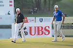 Rafael Cabrera Bello of Spain (in blue) and Sam Brazel of Australia (in black) walk during the 58th UBS Hong Kong Golf Open as part of the European Tour on 10 December 2016, at the Hong Kong Golf Club, Fanling, Hong Kong, China. Photo by Marcio Rodrigo Machado / Power Sport Images