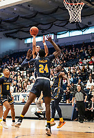 WASHINGTON, DC - FEBRUARY 22: Armel Potter #2 of George Washington lobs a shot over Jared Kimbrough #24 of La Salle during a game between La Salle and George Washington at Charles E Smith Center on February 22, 2020 in Washington, DC.