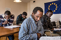 An Italian languague class for refugees at  the refugee center of Tor Sapienza, a suburb of Rome, According to European rules, the first country hit by illegal immigrants fleeing their countries (mostly  Africans)  must  take care of  hosting them while  deciding what to do with this human and social touching cases. Surrounded by Sea, Italy receives a good portion of this unexpected and unwanted guests who reaches by any means the island of  Lampedusa .The turmoil and unrest in Northern Africa, the fall of dictator  Gheddafi in Lybia and the unstoppable war in Syria have worsen this panorama.<br /> Once in Lampedusa  island, those who ask for  political asylum are transported by Italian Government  to special facilities to prove their sayings and getting ,or not , the right to stay in Europe.<br /> After what seemed an endless bureaucracy, our photographer Lorenzo Moscia got the  authorization  to visit one of such center in the Tor Sapienza, where 40 immigrants wait for their fate. Helped by a good willing group of Italian who teach the immigrants  their language and try to organize their cases, this center was in the middle of a series of attacks by poor Italian neighbors who regard this immigrants like a danger to their jobs and life style. A sort poor against the poorer war. That attacked during last November 2014 put in danger the life of all the inmigrants, including their child who must have to be moved to safer places by the authorities.<br /> Now things seems a little easier but tension persists, Lorenzo got inside Tor Sapienza many times to shows us how immigrants are still trying to set up a new life.