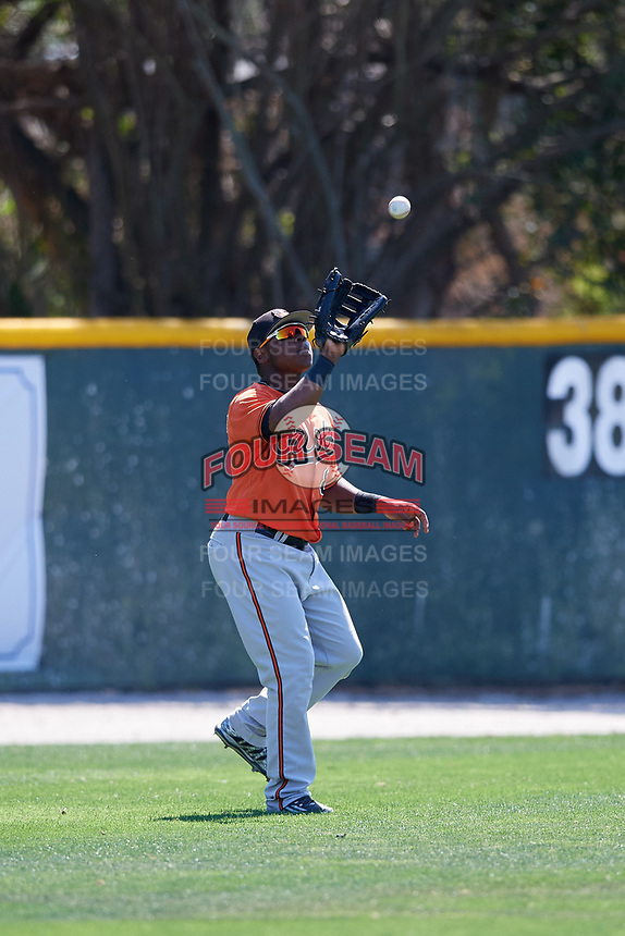 Baltimore Orioles Ademar Rifaela (85) prepares to catch a fly ball during a minor league Spring Training game against the Tampa Bay Rays on March 29, 2017 at the Buck O'Neil Baseball Complex in Sarasota, Florida.  (Mike Janes/Four Seam Images)