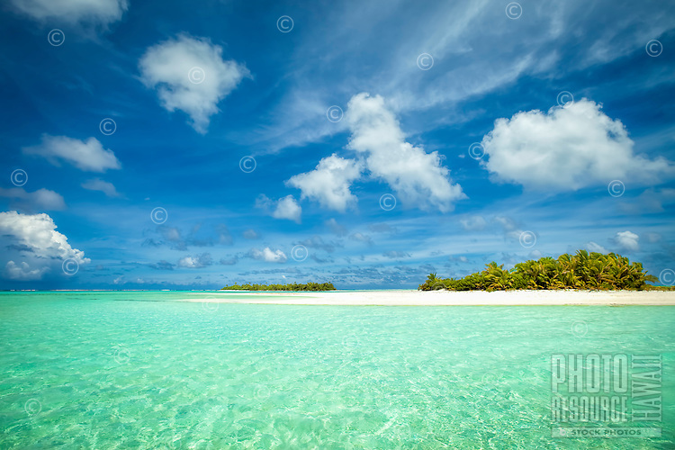 Honeymoon Island, with Motu Maina (a.k.a. Maina Island) in the distance, in Aitutaki Lagoon, Aitutaki Atoll, Cook Islands.