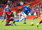 Aberdeen v St Johnstone…18.09.21  Pittodrie    SPFL<br />Murray Davidson is brought down by Jay Emmanuel-Thomas<br />Picture by Graeme Hart.<br />Copyright Perthshire Picture Agency<br />Tel: 01738 623350  Mobile: 07990 594431