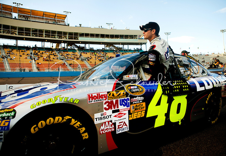 Coverage of Jimmie Johnson, driver of the #48 Lowe's Chevrolet, climbs into his car during practice for the NASCAR Sprint Cup Series Checker O'Reilly Auto Parts 500 at Phoenix International Raceway in Avondale, Arizona