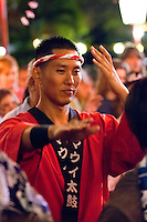 A man in traditional Japanese attire enjoys the annual obon dance at Lahaina Jodo Buddhist Mission, Lahaina, Maui