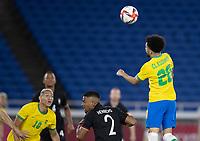 22nd July 2021; Stadium Yokohama, Yokohama, Japan; Tokyo 2020 Olympic Games, Brazil versus Germany; Claudinho of Brazil climbs above Benjamin Henrichs of Germany to win a clearing header