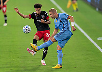 WASHINGTON, DC - SEPTEMBER 06: Kevin Paredes #30 of D.C. United fights for the ball with Anton Tinnerhold #3 of New York City FC during a game between New York City FC and D.C. United at Audi Field on September 06, 2020 in Washington, DC.