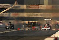 Nov 1, 2007; Pomona, CA, USA; NHRA top fuel dragster driver Rod Fuller (left) races alongside Larry Dixon during qualifying for the Auto Club Finals at Auto Club Raceway at Pomona. Mandatory Credit: Mark J. Rebilas-US PRESSWIRE