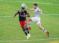 WASHINGTON, DC - NOVEMBER 8: Ola Kamara #9 of D.C. United heads the ball over Rudy Camacho #4 of the Montreal Impact during a game between Montreal Impact and D.C. United at Audi Field on November 8, 2020 in Washington, DC.