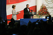 WASHINGTON DC - JANUARY 20: US President George W. Bush and his wife Laura at the Texas/ Wyoming inaugural ball January 20, 2005 in Washington DC. (photo by Anthony Suau)