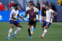 6th June 2021. Denver, Colorado, USA;  Mexico forward Jesus Corona challenges United States defenders DeAndre Yedlin and Mark McKenzie  during the CONCACAF Nations League finals between Mexico and the United States at Empower Field at Mile High in Denver, CO.