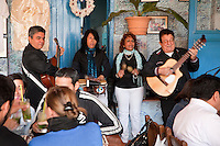 Cuba, Havana.  La Bodeguita del Medio.  Musicians Playing, Singing.