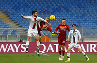 Genoa's Francesco Cassata, left, and Roma's Rick Karsdorp jump for the ball past Roma's Gianluca Mancini, second from right, and Genoa's Eldor Shomurodov, during the Italian Serie A Football match between Roma and Genoa at Rome's Olympic stadium, March 7, 2021.<br /> UPDATE IMAGES PRESS/Riccardo De Luca