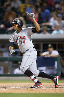 Willy Garcia (24) of the Indianapolis Indians follows through on his swing against the Charlotte Knights at BB&T BallPark on June 17, 2016 in Charlotte, North Carolina.  The Knights defeated the Indians 4-0.  (Brian Westerholt/Four Seam Images)