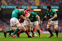 Pictured: Ken Owens of Wales is tackled by Peter O'Mahony of Ireland during the Guinness six nations match between Wales and Ireland at the Principality Stadium, Cardiff, Wales, UK.<br /> Saturday 16 March 2019