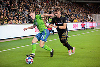 LOS ANGELES, CA - OCTOBER 29: Brad Smith #11 of Seattle Sounders FC dribbles to the corner past Tristan Blackmon #27 of Los Angeles FC during a game between Seattle Sounders FC and Los Angeles FC at Banc of California Stadium on October 29, 2019 in Los Angeles, California.