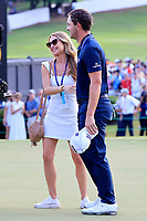 5th September 2021: Atlanta, Georgia, USA; Girlfirend Nikki Guidish greets Patrick Cantlay after he wins the TOUR Championship and FedEx Cup  at the East Lake Club in Atlanta, Georgia.