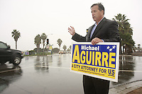 Tuesday, November 4 2008.  Incumbent City Attorney Michael Aguirre is soaking wet as he stands in the rain at the corner of Sunset Cliffs and Nimtz Blvd during morning rush-hour on election day, November 4, 2008.  Rain fell early in San Diego on what is expected to be a record-breaking day at the polls.