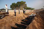 Men buried about 340 bodies in a mass grave at a cemetery in Sirte, Libya, Oct. 25, 2011. A crew catalogued and collected DNA from them before burying them.