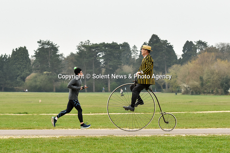 Pictured: Stuart Mason-Elliott, also known as Mr Samuel Pickwick as President of the oldest cycling club in the world The Pickwick Bicycle Club, rides his original 1872 Coventry Machinist Company penny farthing wearing the traditional club uniform at Southampton Common in Southampton, Hants.<br />  <br /> Stuart rides a 22 kilogram, iron frame penny farthing which is believed to be one of the first bicycles ever made. The wheel diameter is 48 inches, with each bicycle being specially tailored to the leg length of the rider.<br />  <br /> Stuart was elected president of The Pickwick Bicycle Club, formed in 1870  for the second consecutive year, due to Covid-19 restrictions on club activities. Members wear the traditional club uniform of a yellow and black striped blazer, waistcoat with a straw boater hat and are also assigned a sobriquet of a character from The Pickwick Papers, which they represent. <br /> <br /> © Jordan Pettitt/Solent News & Photo Agency<br /> UK +44 (0) 2380 458800