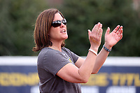 GREENSBORO, NC - MARCH 11: Head coach Janelle Breneman of UNC Greensboro encourages her team during a game between Northern Illinois and UNC Greensboro at UNCG Softball Stadium on March 11, 2020 in Greensboro, North Carolina.