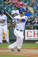 Round Rock Express first baseman Carlos Pena (33) follows through on his swing during the Pacific Coast League baseball game against the Fresno Grizzlies on June 22, 2014 at the Dell Diamond in Round Rock, Texas. The Express defeated the Grizzlies 2-1. (Andrew Woolley/Four Seam Images)
