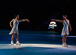 Two Skaters in White