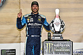 Monster Energy NASCAR Cup Series<br /> Go Bowling 400<br /> Kansas Speedway, Kansas City, KS USA<br /> Sunday 14 May 2017<br /> Martin Truex Jr, Furniture Row Racing, Auto-Owners Insurance Toyota Camry celebrates his win in Victory Lane<br /> World Copyright: Nigel Kinrade<br /> LAT Images<br /> ref: Digital Image 17KAN1nk09859