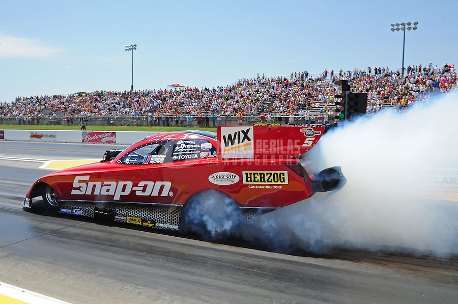 May 19, 2012; Topeka, KS, USA: NHRA funny car driver Cruz Pedregon during qualifying for the Summer Nationals at Heartland Park Topeka. Mandatory Credit: Mark J. Rebilas-