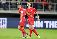 WASHINGTON, D.C. - OCTOBER 11: Christian Pulisic #10 of the United States scores a penalty kick goal and celebrates with teammate Josh Sargent #19 during their Nations League game versus Cuba at Audi Field, on October 11, 2019 in Washington D.C.