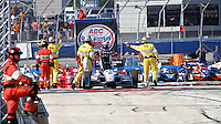 Juan Pablo Montoya climbs from his car after the Milwaukee Indy Fest 250, Milwaukee Mile Speedway, Milwaukee, WI, August 2014.  (Photo by Brian Cleary/www.bcpix.com)