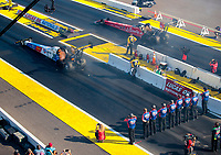 Aug 17, 2019; Brainerd, MN, USA; Crew members line up behind the starting line as NHRA top fuel driver Brittany Force launches her dragster off the starting line alongside Doug Kalitta during qualifying for the Lucas Oil Nationals at Brainerd International Raceway. Mandatory Credit: Mark J. Rebilas-USA TODAY Sports