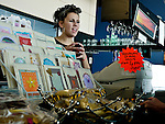 A retail shop assistant talks to a customer in a gift shop in Southport England