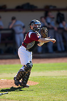 Winthrop Eagles catcher Roger Gonzalez (16) makes a throw to first base against the Kennesaw State Owls at the Winthrop Ballpark on March 15, 2015 in Rock Hill, South Carolina.  The Eagles defeated the Owls 11-4.  (Brian Westerholt/Four Seam Images)