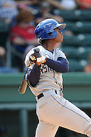 Left fielder Raimel Tapia (15) of the Asheville Tourists bats in a game against the Greenville Drive on Sunday, July 20, 2014, at Fluor Field at the West End in Greenville, South Carolina. Tapia is the No. 10 prospect of the Colorado Rockies, according to Baseball America. Asheville won game one of a doubleheader, 3-1. (Tom Priddy/Four Seam Images)