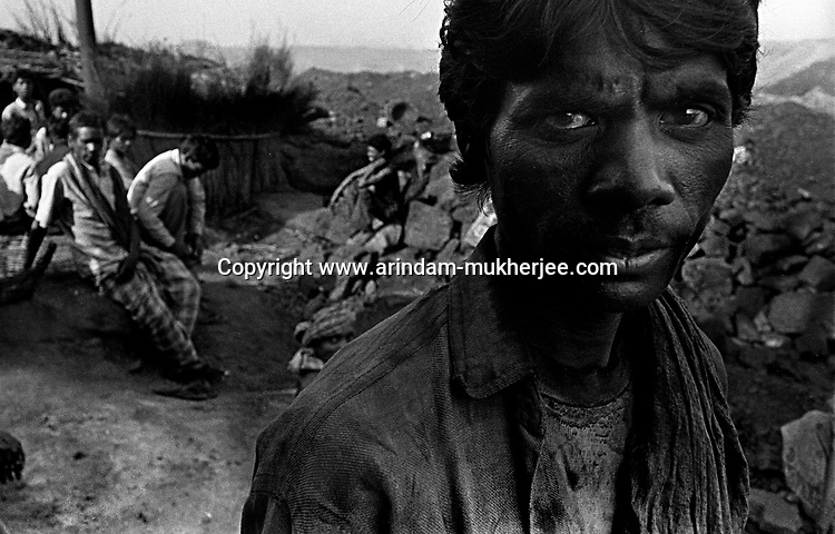 A miners face smeared with coal dust after he comes out of his day's work, Jharia, Jharkhand, India . Jharkhand, India. Arindam Mukherjee