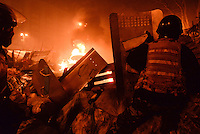 Barricades built on Maidan square in the last three months are now burning under the repressive assault of the police .  Kiev, Ukraine