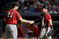 Erie SeaWolves pitcher Drew Carlton (23) and catcher Kade Scivicque (20) shake hands after closing out an Eastern League game against the Akron RubberDucks on August 30, 2019 at Canal Park in Akron, Ohio.  Erie defeated Akron 3-2.  (Mike Janes/Four Seam Images)